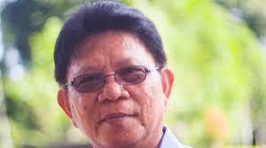 Dr. Robert Winerungan M.Si